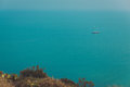 Beautiful Landscape With The Horizon Of The Sea And A Sailboat In The Calm Waters Of The Sea In The Afternoon. Royalty Free Stock Image - 98107906
