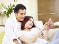Young Asian Couple Chatting At Home Royalty Free Stock Photo - 98187205