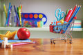 Back To School Shopping Cart With Supplies On Wooden Table. Royalty Free Stock Photo - 98188415