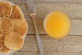 Breakfast With Pancakes And Orange Juice With Metal Fork On A Wooden Table Royalty Free Stock Images - 98212299