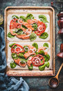 Tarte Flambee With Salmon , Spinach And Tomatoes , Cooking Preparation On Rustic Kitchen Table Background Stock Photos - 98280883