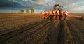 Farmer With Tractor Seeding - Sowing Crops At Agricultural Field Royalty Free Stock Photography - 98284127