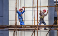 A Builder Walking On A Scaffolding Stock Photo - 98287650