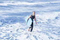 Blond Woman In Wetsuit And Swimming Board In The Water Stock Photo - 98288560