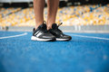 Close Up Of A Male Legs In Sneakers Standing Stock Image - 98295061