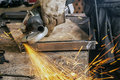 Close Up Grinds A Metal Product With Angle Grinder Stock Photos - 98343133