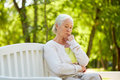 Sad Senior Woman Sitting On Bench At Summer Park Royalty Free Stock Photos - 98363208