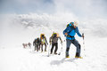 A Group Of Mountaineers Climbs To The Top Of A Snow-capped Mountain Royalty Free Stock Images - 98366479
