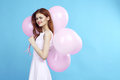 Beautiful Young Woman Holds Balloons On A Blue Background, Blank Space For Copy Stock Image - 98377141