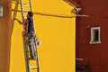 Close-up Of Painter Painting Wall Of House Of Yellow In Burano. Royalty Free Stock Photography - 98382957