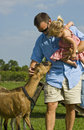 Man And Baby With Goat Stock Image - 9845741