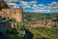Overview Of Stone Tower, Green Hills, Vineyards And Town Rooftops Near A Road. From The City Center Of Orvieto. Royalty Free Stock Photos - 98411358
