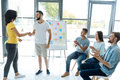 Delighted Young People Doing A Teambuilding Activity Royalty Free Stock Image - 98413366