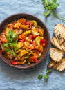 Healthy Vegetarian Lunch - Stewed Garden Vegetables. Vegetable Ratatouille And Grilled Bread. On A Blue Background Stock Photo - 98425230