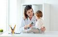 Doctor With Baby And Otoscope At Clinic Royalty Free Stock Image - 98428716