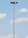 Tall Steel  Lamp In The Park On Blue Sky In Background. Stadium Light, Spot Light Pole Royalty Free Stock Photography - 98453997