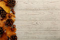 Flat Lay Frame Of Autumn Leaves, Cones And Nuts On A Wooden Back Stock Photo - 98464860