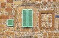 Green Window Shutters On Old Stone Textured Wall, Italy Stock Photography - 98491932