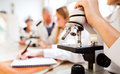 Unrecognizable High School Student With Microscope In Laboratory Stock Photos - 98500913