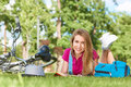 Young Woman Reading A Book After Cycling At The Local Park Stock Photo - 98573870