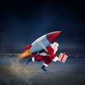 Fast Delivery Of Christmas Gifts Ready To Fly With A Rocket Royalty Free Stock Photography - 98611097