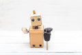 The Robot Holds The Car Keys In His Hand Royalty Free Stock Image - 98631976