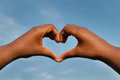 Black Hands In Heart Shape With Sky Background Royalty Free Stock Image - 98640036
