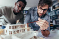 Architects Working On New Architectural House Model Stock Photo - 98640180