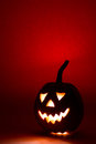 Halloween Pumpkin, Funny Face On Red Background Royalty Free Stock Image - 98662086