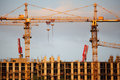 Two Cranes On Building Building Royalty Free Stock Photos - 9873478