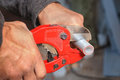 Plumber Cuts The Ppr Pipe Using A Cutter. Stock Images - 98754324