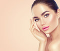 Beauty Spa Brunette Woman Touching Her Face Royalty Free Stock Photos - 98787928