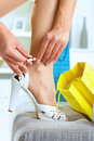 Woman Fitting High Heel Shoes Royalty Free Stock Images - 9886499