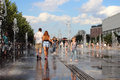 Girl And Boy Walking Along The Jets Of The Water Of The Museon Fountain. Royalty Free Stock Photos - 98805308