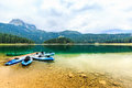 Kayaks Docked On The Shore Of Black Lake. Mountain Landscape, Durmitor National Park, Zabljak, Montenegro. Royalty Free Stock Images - 98819579