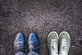 Sneakers And Business Shoes Side By Side On Asphalt, Work Life Balance Royalty Free Stock Photography - 98849457