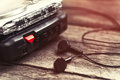 Vintage Walkman Cassette Player With Earbuds And Tape Cassette Stock Image - 98870251