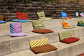 Pillows On Concrete Steps Royalty Free Stock Photography - 9892097