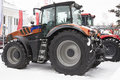 Agricultural Tractor At Winter Snow Day Royalty Free Stock Images - 98906269