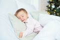 Child Girl Sleep In Her Bed In Christmas Morning Royalty Free Stock Photos - 98910008