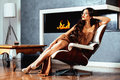 Beauty Yong Brunette Woman Sitting Near Fireplace At Home Stock Image - 98914191