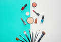 Cosmetics White And Blue Background With Make Up Artist Objects: Lipstick, Eye Shadows, Mascara ,eyeliner, Concealer, Nail Polish. Stock Photography - 98936942