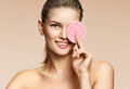 Smiling Girl Cleaning Face With Exfoliating Sponge Stock Photo - 98974060