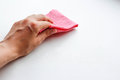 Female Hand Wiping The Dust Pink Cloth. Wet Cleaning. Closeup. I Royalty Free Stock Photography - 98983417