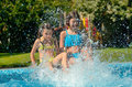 Summer Fitness, Kids In Swimming Pool Have Fun, Smiling Girls Splash In Water Stock Photography - 98994422