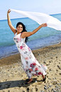 Beautiful Young Woman At Beach With White Scarf Stock Photography - 9904982