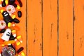 Halloween Candy Side Border Over Old Orange Wood Stock Photography - 99013852