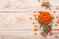 Sea Buckthorn. Ripe Fresh Berries In Bowl On White Wooden Background With Copy Space For Your Text. Top View Royalty Free Stock Photo - 99075715