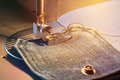 Foot Of Sewing Machine On Jeans Fabric Toned, Warm Light Royalty Free Stock Image - 99094546