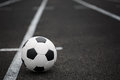 A Classic Football Ball On An Asphalted Path Background. Children Training Soccer. Healthy Lifestyle. A Ball On A Grass. Royalty Free Stock Photo - 99098005